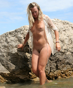 Hot nude babe on the naked beach