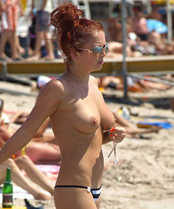 Lovely ladies getting fun on the nude beach