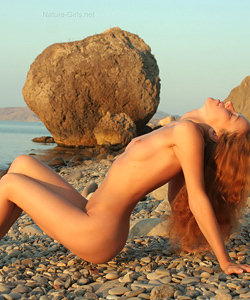 Nature naked babe on the rock