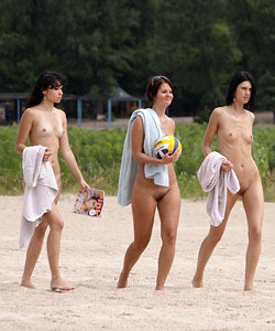 Three naked brunettes on a nude beach